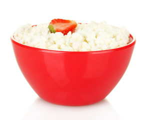 cottage cheese in red bowl with strawberry isolated on white