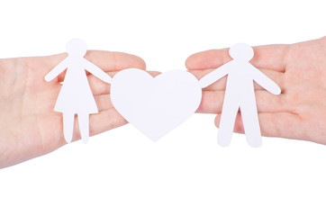 Paper family in hand with a big hearth isolated on white