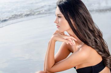 Beautiful girl looking at the sea waiting