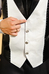Wedding suit detail with lost buttom
