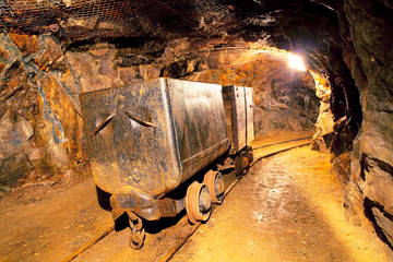 Wall Mural - Cart in gold mine - underground
