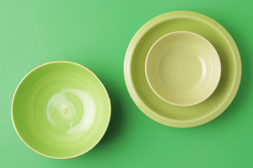 top shot green bowl and plate on green background