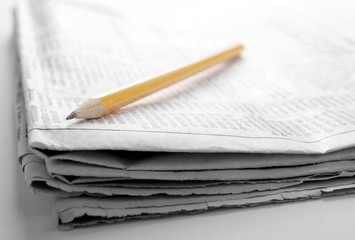 newspaper with news closeup on white background