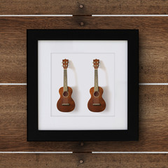 ukulele in frame on the wood wall