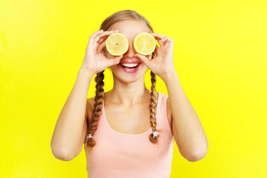 young girl holding lemons