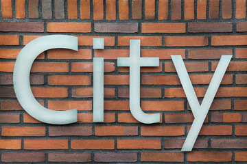 Metal sign of the word City