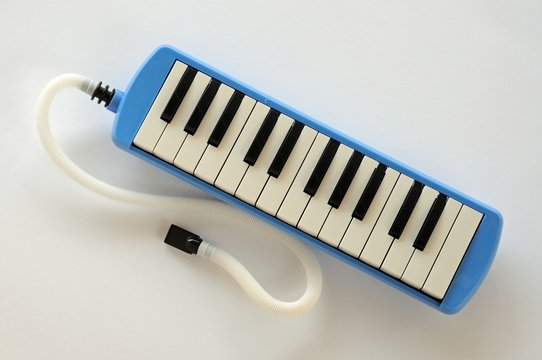 Blue Pianica with mouthpiece © Arena Photo UK