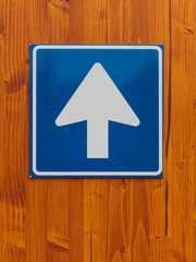 One way traffic sign on wooden wall