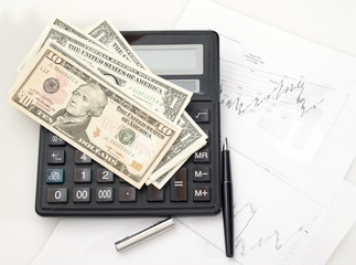 Chart, calculator, pen. Dollars. Tools of investor and trader.