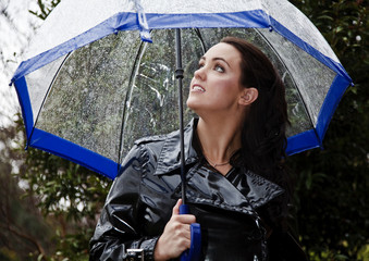 Attractive young woman dressed for rain