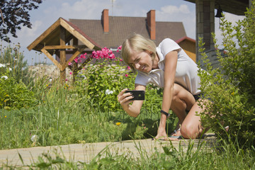 Young girl taking picture