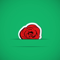 Green card with red rose in paper slit