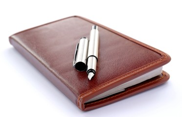 check book and a fountain pen on a white background