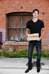 Man Holding an Unemployment Sign
