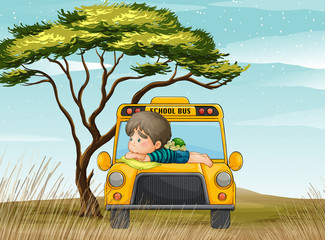 a school bus and boy