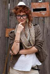 Red haired hipster girl posing