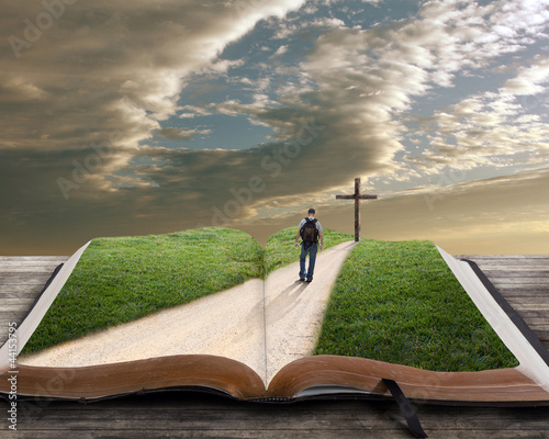 Wall mural Open bible with man and cross