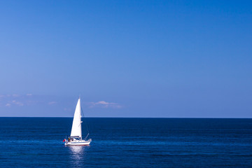 Isolated Yacht in the blue sea
