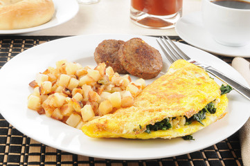 Breakfast omelet with sausage and hash browns