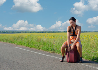 Dejected woman waiting for a lift