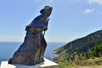 statue of a pilgrim at cape fisterra galicia spain Fotomurales
