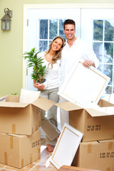 Happy couple moving in a new house.
