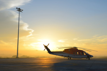 silhouette of helicopters on the apron