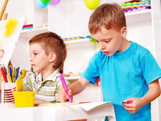 Children painting  in kindergarten.