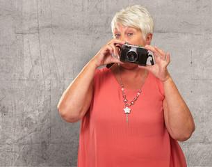 Senior Woman Holding Camera