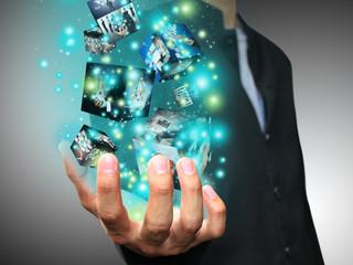 Businessman holding virtual box