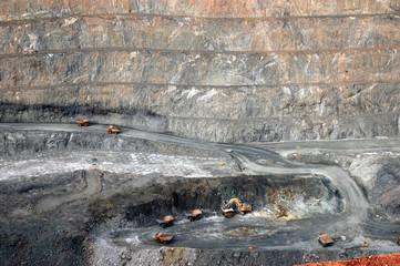 Trucks in Super Pit gold mine Australia