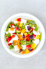 Fresh Bowl of Bell Peppers and Onions