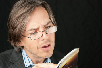Casual Businessman Wearing Reading Glasses Reading Book