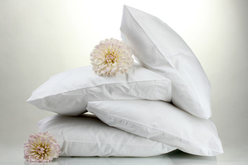 pillows and flowers, on grey background