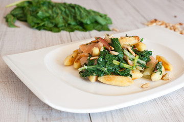 fresh salad with chard and pine nuts