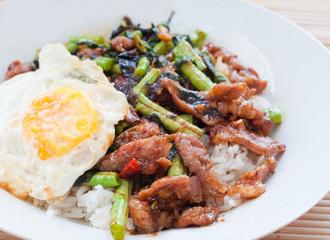 stir fried pork with basil and fried egg on rice