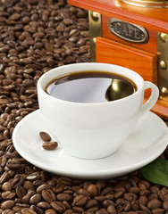 coffee cup and beans with grinder