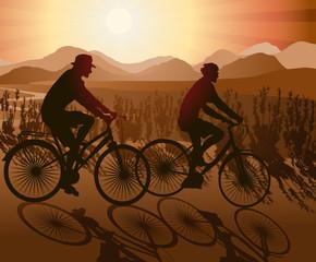 Biking Couple Enjoying Sunset View