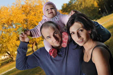 happy family  autumn outdoors