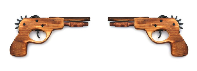 Toy wooden gun , on a white background