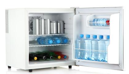 mini fridge full of bottles and jars with various drinks