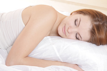young happy woman sleeping