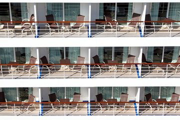 Many balconies with chairs table on ship, front
