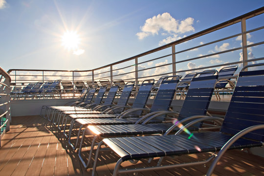 Chaise longues on deck of cruise ship