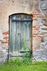 Wooden door of an old barn