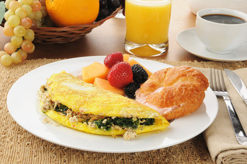 Spinach and feta cheese omelet with a croissant