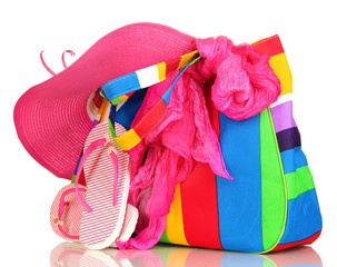 Beach bag with accessories isolated on white