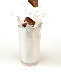 Chocolate cubes splashing into a milk glass. On white background