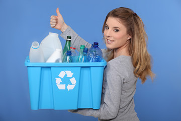 Woman recycling empty bottles