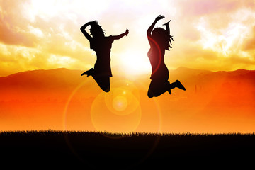 Silhouette illustration of two girls jumping happily